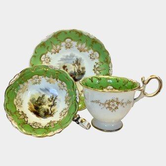 This is very attractive antique true trio made by Coaport c1835 green border with fabulous hand painted English scenes.      Coalport true trio green border with hand painted English scenes, pattern 3/215