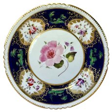 Rare an early Rockingham dinner plate, marked red griffin c1826-1830