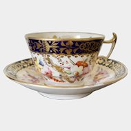 Coalport cup and saucer hand painted gilt flowers in London shape c1825