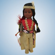 Vintage Native American Celluloid Tourist Souvenir Doll with Amber Eyes