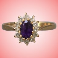 9 kt Gold Ring with Purple Stone and Halo of White Stones Size N 1/2