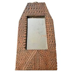 A Small Mirror in a One Piece Chip Carved Frame