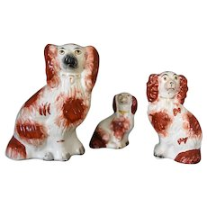 A Trio of Antique Staffordshire Spaniels in White and Russet with Soft Gilt Collars