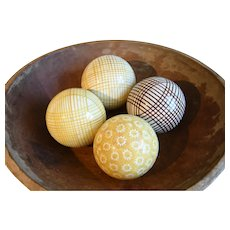 A Group of Four Yellow and Brown Spongeware Late 19th Century Carpet Balls