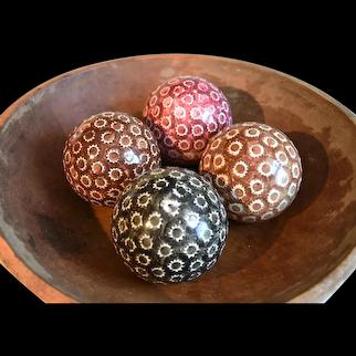 A Group of Four Polychrome Spongeware Late 19th Century Carpet Balls