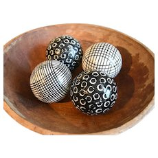 A Group of Four Black and White Spongeware Late 19th Century Carpet Balls