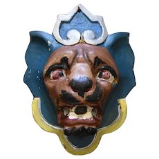 A Carved and Painted Lion's Head