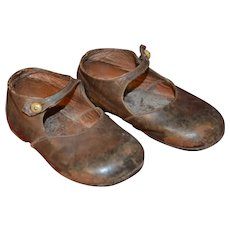 Antique brown leather child shoes