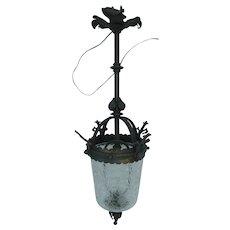 Hanging wrought iron lantern with round cracked glass base, France, 1900