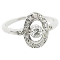 Vintage platinum ring with old brilliant cut and half cut diamonds