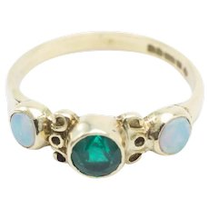 Opal and emerald ring in 18 carat gold