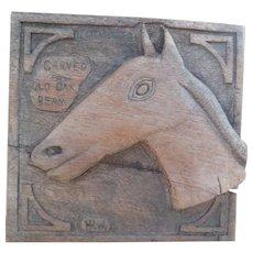 Naive folk art carving of a horse