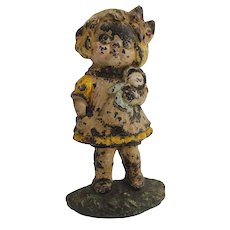 Girl with doll doorstop