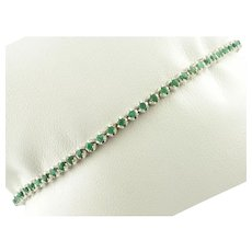 Tennis Bracelet in 18k White Gold and Emeralds