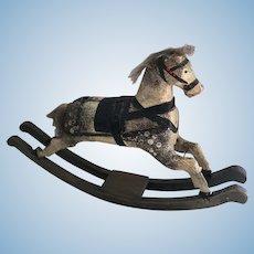 Antique miniature wooden dolls rocking horse