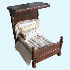 Wonderful antique wooden dolls house tester bed