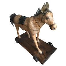 Antique 19th century carved wooden toy horse on wheels