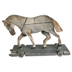 Antique folk art pull along wooden horse toy