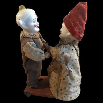 Antique German bisque headed clockwork dancing clowns