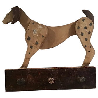 Rare early Folk Art dog plaque with hooks