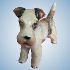 Antique bisque fox terrier dog