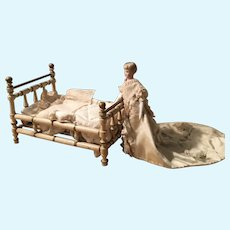 Rare antique wooden Christian Hacker dolls house bed