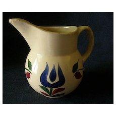 "Watt Pottery ""#15 Dutch Tulip"" Pattern Pitcher"