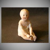 "Gebruder Heubach  3"" Seated ""Boy"" Piano Baby Figurine"