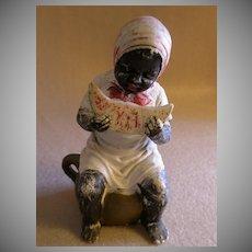 Black Americana Figurine - Girl on Chamber Pot Eating Watermelon