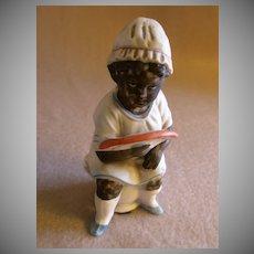 Black Americana Figurine - Black Girl Sitting on Chamber Pot & Holding a Fan