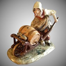 """Ernst Bohne Sohne/Volkstedt Germany Porcelain Figurine """"Woman with Wheelbarrow Holding a Whiskey Keg"""""""