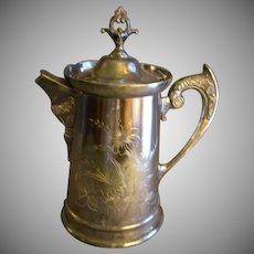 Rockford Silver Plate Co. Ice Water Lidded Pitcher w/Floral Engraved Motif
