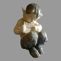 """Royal Copenhagen Figurine """"Faun With A Pan Flute"""" #1736, Sculptured by Christian Thomsen"""