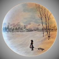 "Home Studio Hand Painted ""Scenic Child with Sled Playing in the Snow"" Plate"