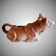 Bavaria Medium Brown Reclined Cow Figural Cream Pitcher