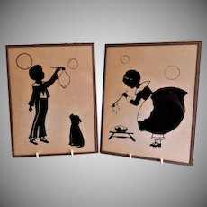 "Vintage Revere Painted on Glass Silhouettes - Pair - ""Girl & Boy Blowing Bubbles"""