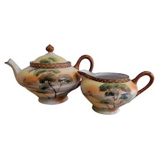 Nippon Moriage Hand Painted Teapot & Creamer with a Scenic Motif (Maple Leaf Mark)