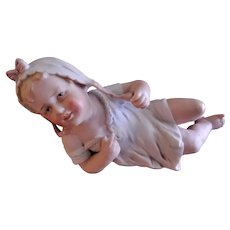 Unger & Schneider Company Partially Reclining Piano Baby Figurine - Small Size