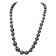 Antique 19th century Whitby jet beads with a gold clasp, 26 inches
