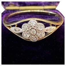 Antique Edwardian diamond cluster flower ring in 18-carat gold and platinum, circa 1910