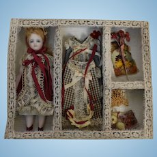 """4 3/4"""" Cathy Hansen All-Bisque Doll with Decorative Box and Trousseau"""