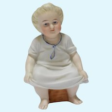 """3 1/4"""" Porcelain Figure of a Seated Child"""