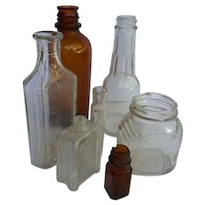 Vintage lot of seven elderly bottles complete with chips, dust and wear