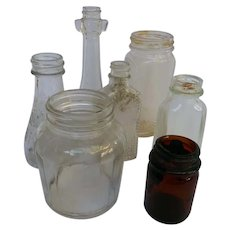 Collection of 7 vintage bottles for flowers or decor