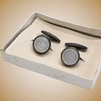 Pair of cufflinks with mother of pearl and metal