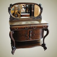 Quarter Sawn Oak Sideboard with Oval Mirror and Cherubs