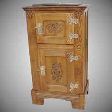 Oak 2 Door Ice Box with Carving and Ornate Cast Brass Hardware