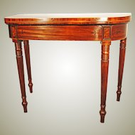 Regency mahogany inlaid games table