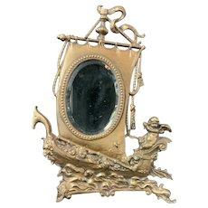 Victorian Brass Wash Frame with Cherub Commanding Ship Sail holds Original Glass Beveled Mirror