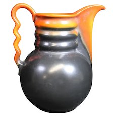 Louis Regout - Colorful Mosa Jug With Wavy Handle.